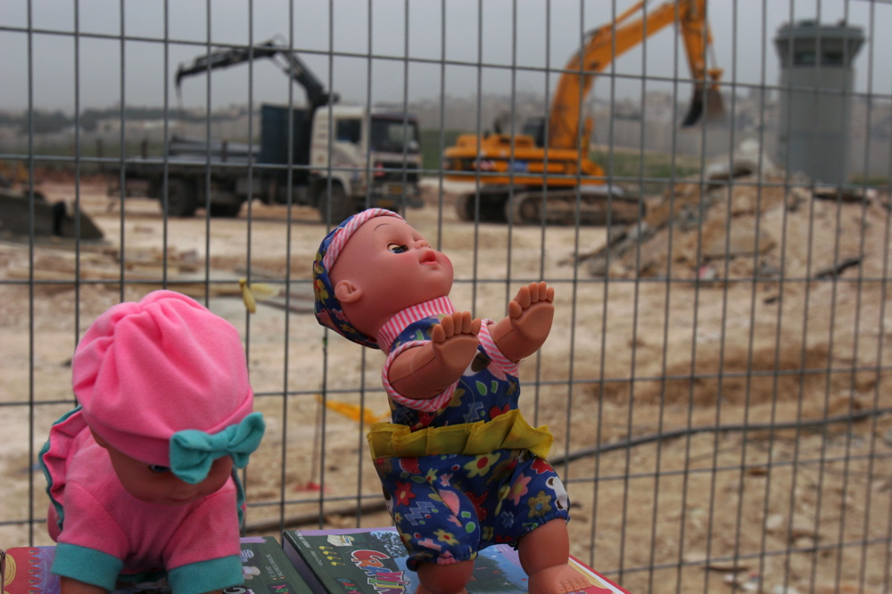 Dolls at Kalandia checkpoint Feb 09 06 03 jpg